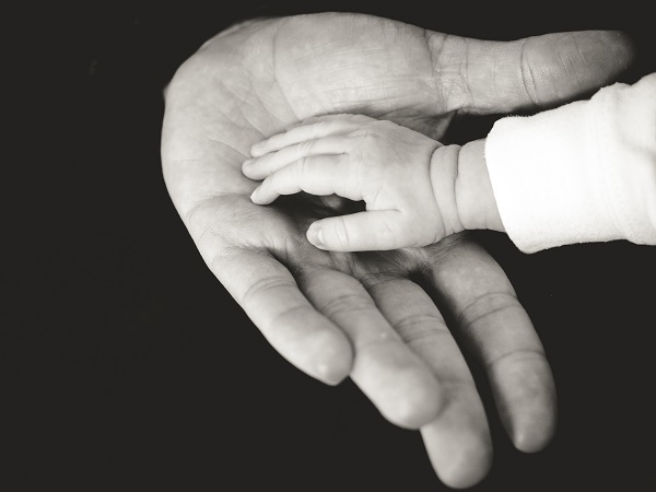 baby's hand in an adult's hand