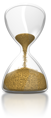hourglass running out of sand resting on rocks