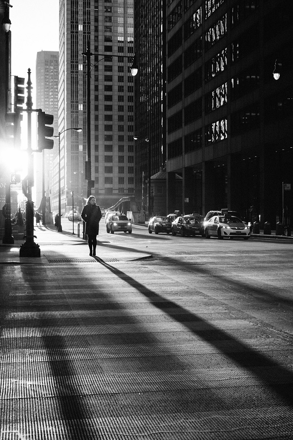 woman walk city shadow